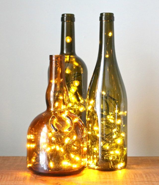 Turn any glass bottle into a glowing focal point with little more than a string of LED Christmas lights and a diamond hole saw drill bit.