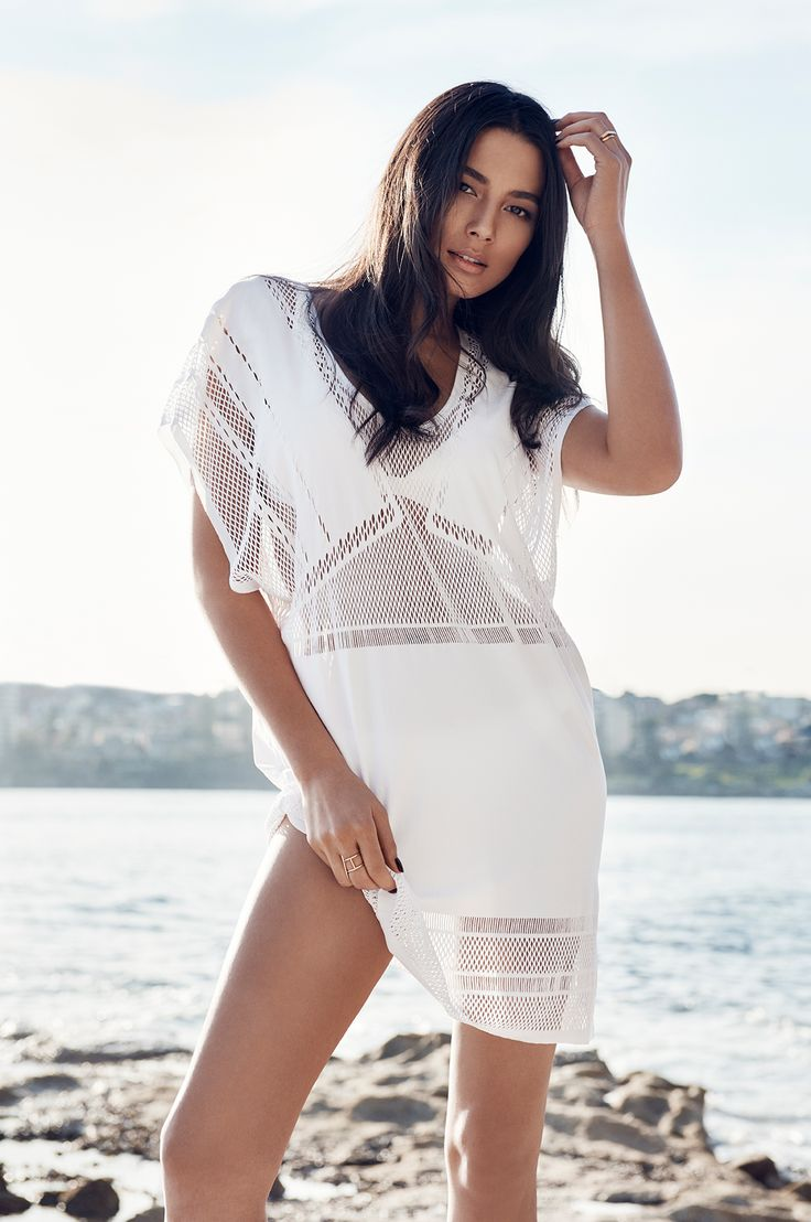 The JETS Swimwear overswim kaftan as seen on Jessica Gomes | Reshape your getaway wardrobe with textural luxury and add this batwing kaftan to your wish list quick! Think fierce edge with panelled cut-out knit detail and a statement-making showcase of modern resort glamour.