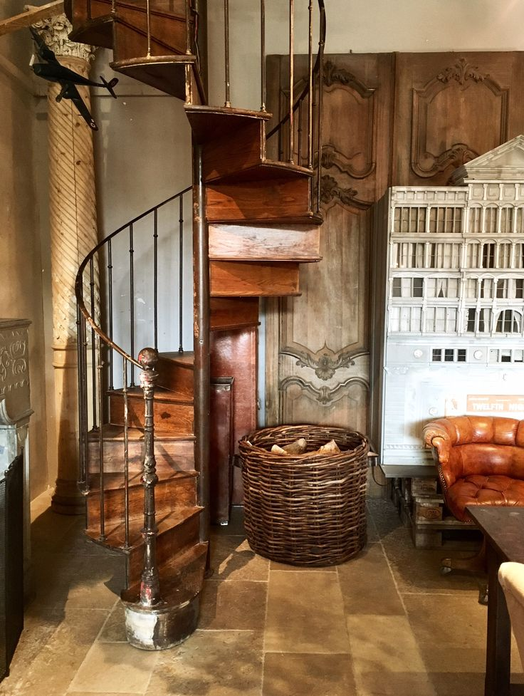 Antique spiral staircase, industrial French antiques, beautiful ornamental wooden doors, vintage theatre, interior design, Piet Jonker, French floor tiles