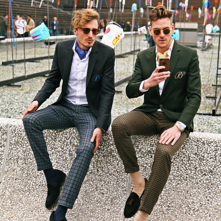 PIETER PETROS    PITTI UOMO I    Pitti Uomo which was originally a Fashion Fair is now a glamorous platform where menswear enthusiasts, from around the world, showcase their own unique style. Sitting on the Pitti wall PP decided to introduce to the world the concept of 'PP Ambassadors' during the winter edition of Pitti Uomo 91.