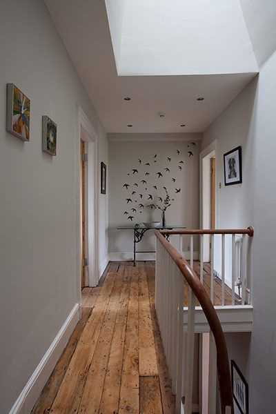 Credit: Lee Garland for the Guardian The landing features an elegant Georgian handrail and birds on the far wall, hand-painted by Bev.