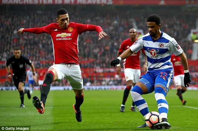 Chris Smalling attempts to stop the delivery of Reading's Garath McCleary out wide