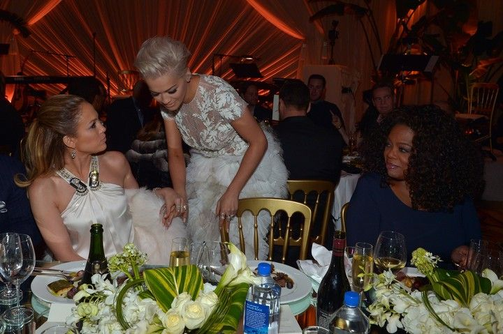 (L-R) Actress/recording artist Jennifer Lopez, recording artist Rita Ora and producer/actress Oprah Winfrey attend The Weinstein Company's Academy Awards Nominees Dinner in partnership with Chopard, DeLeon Tequila, FIJI Water and MAC Cosmetics on February 21, 2015 in Los Angeles, California.