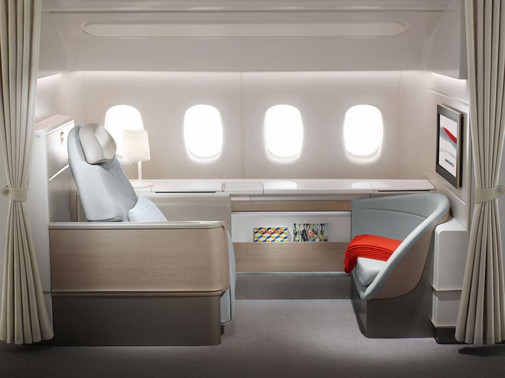Clean, crisp and elegant, Air France's La Premiere cabin features a private wardrobe and a thick adjustable curtain for extra privacy. There's also a reclining ottoman, so guests from other parts of the cabin can visit you mid-flight. Amenities: Bedside reading lamp, 24-inch touchscreen TV, and a seat that easily transforms into a bed.