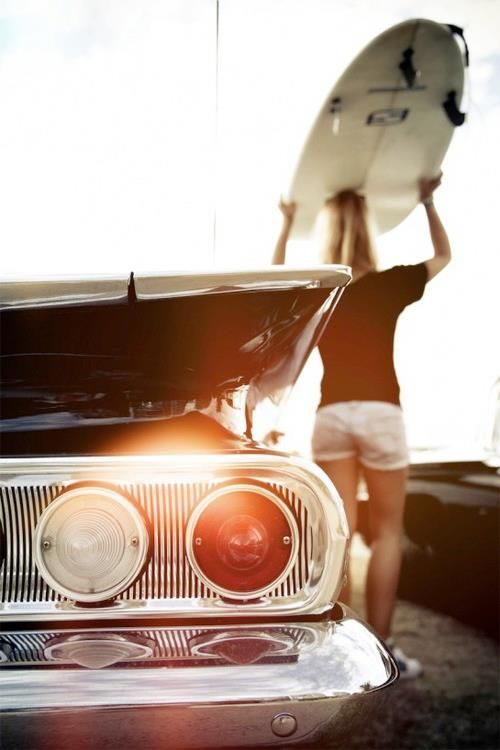 Love the vibe of this photo. The Impala, the surfboard, and the sun shining through in the right spot.