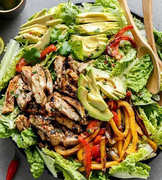 Creamy avocado slices, grilled red and yellow peppers, and fajita flavors make for one incredible salad.