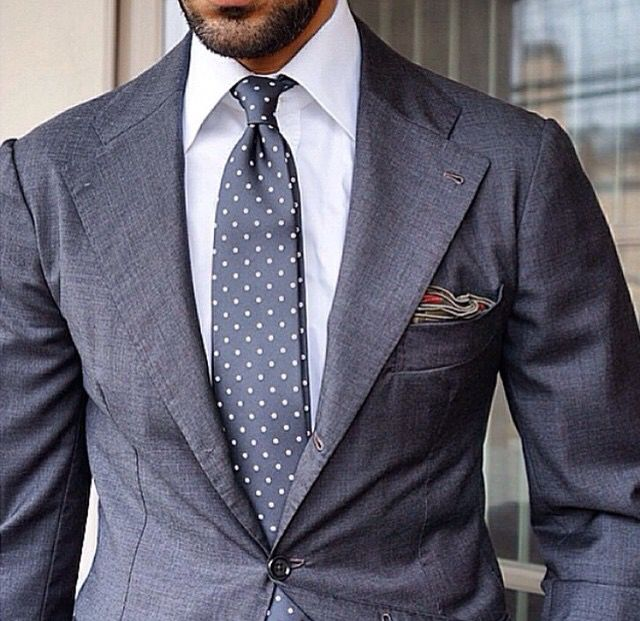 Grey suit / white shirt / grey tie with dots.