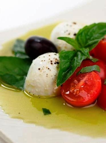 """Delicate taste: Tomatoes, Abruzzi mozzarella balls, olives of Ascoli, basil and EVOO Grand Cru """"Per  Liliana!"""