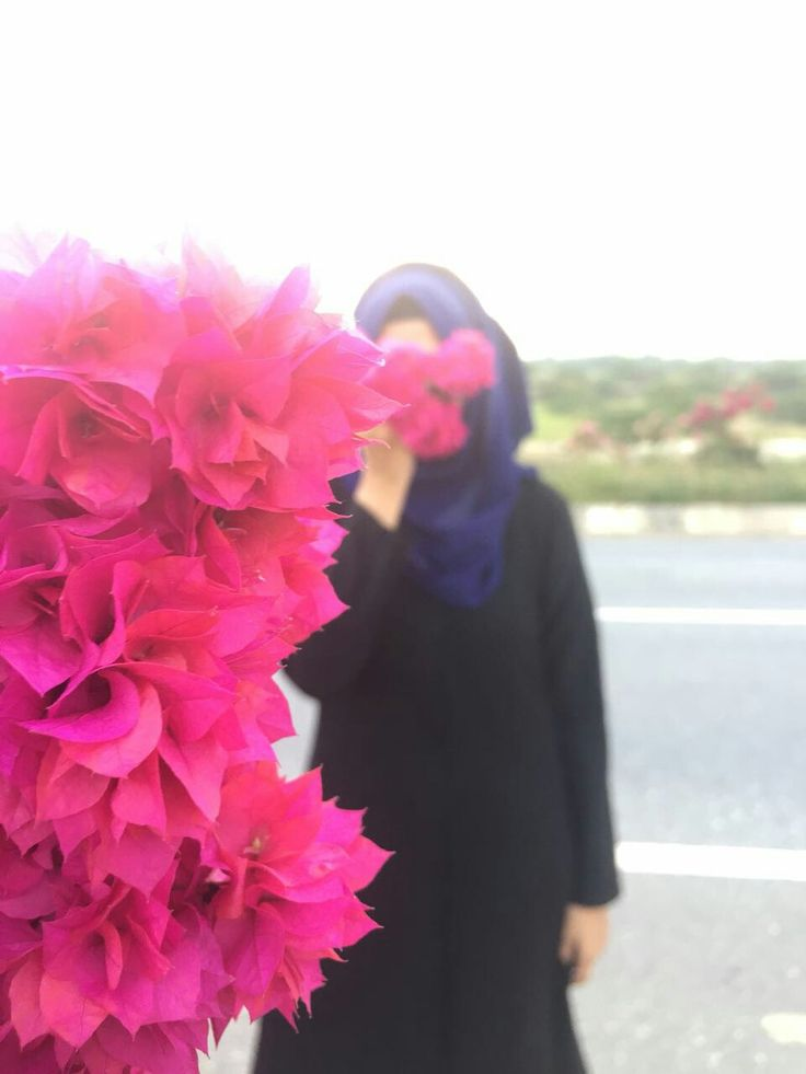 Just beautiful! Blue Hijab and pink flowers.