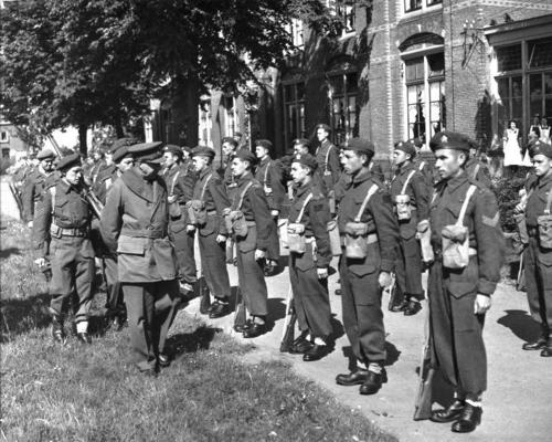18 May 45 – Delfzijl, Netherlands – General Henry [Harry] DG Crerar, OC First Canadian Army, inspects a guard of Perths commanded by Captain George A Gallagher, 'A' Company. Some of these men are still sporting their tans from their time fighting in Italy. Sgt Nick Carter can be seen accompanying the General. In the front rank, from right to left: Sgt McConkey (McConnell?); Pte Tom Branston; unknown; Pte H Near.