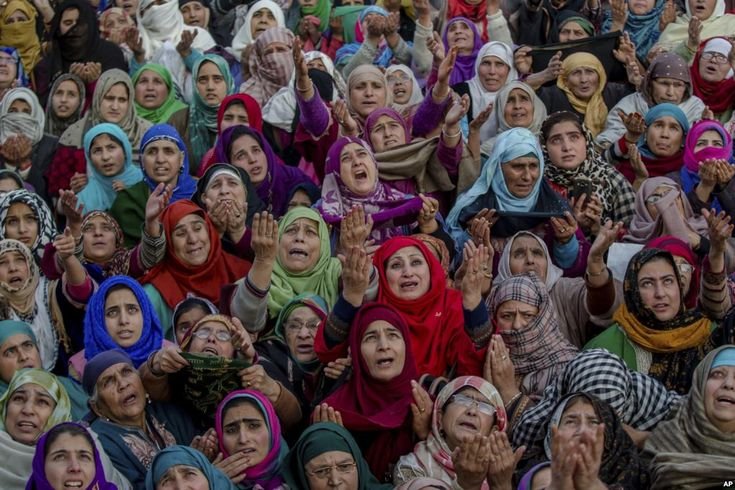 December 1, 2017:  Kashmiri Muslim devotees raise their hands in prayer as a head priest displays a relic of Prophet Muhammad at the Hazratbal shrine on Eid-e-Milad, or the birth anniversary of Prophet Muhammad, in Srinagar, Indian-controlled Kashmir.