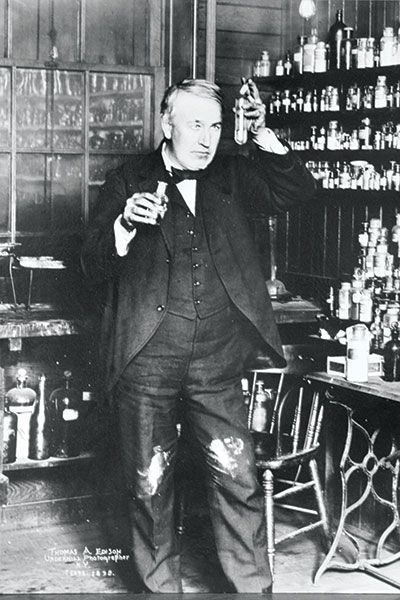 Thomas Edison doing a little experimenting in his chem lab. Check out those stained pants!