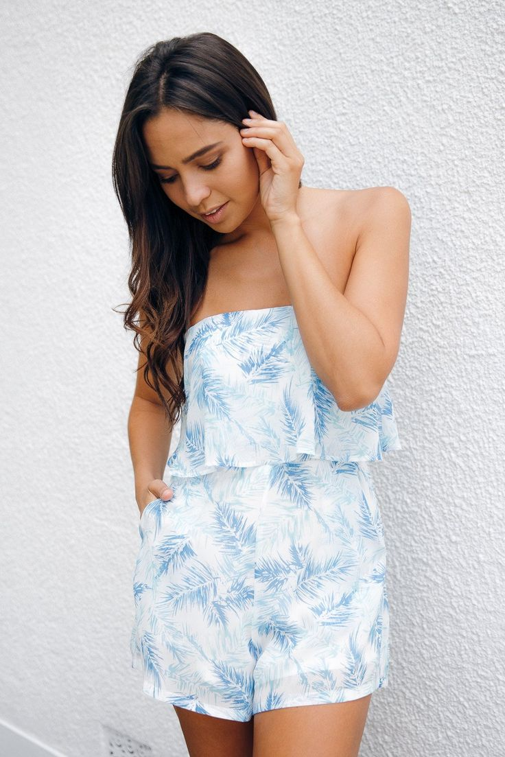Bring a Summer holiday vibe to your weekend wear in the Yasmine Tropical Blue Playsuit. Easy, breezy and bright – the sheer layered fabric features palm leaf effect in shades of blue whilst white lining preserves your modesty. The strapless, boned shape and frill skims the bust and cinches in at ...