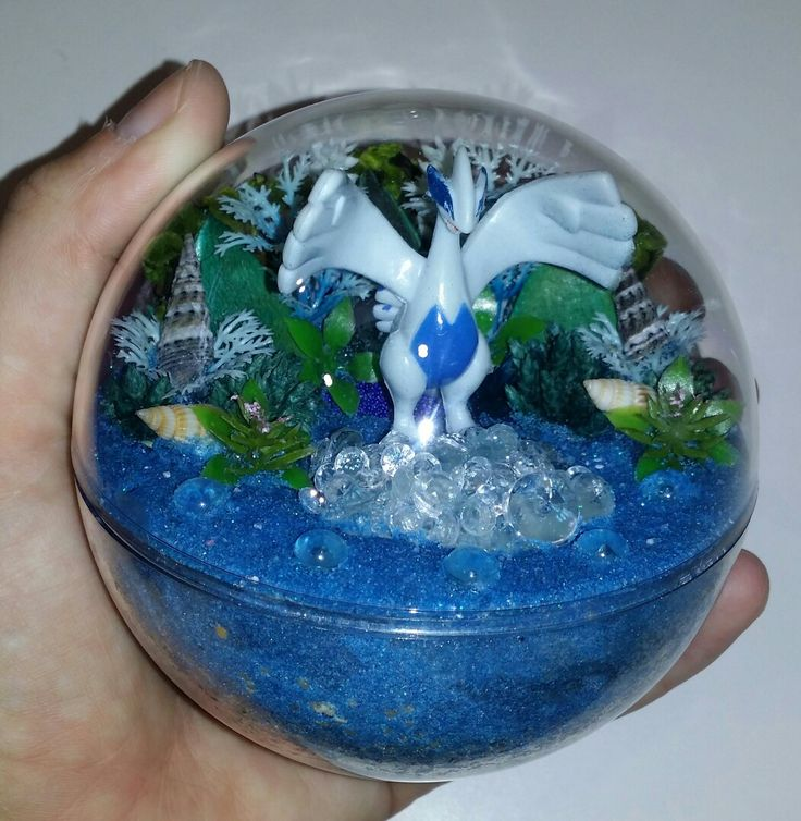 Lugia Pokemon habitat ball  Miniature artificial terrarium  To see all the Pokemon habitat balls I have made please visit my Facebook page https://m.facebook.com/sparklesandstring/