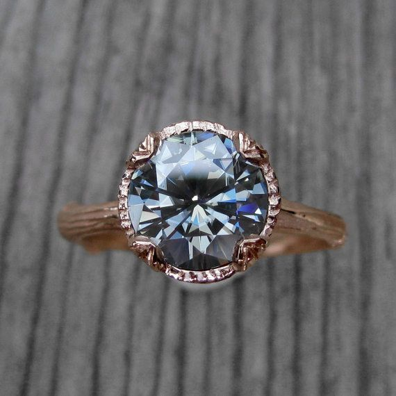 This striking grey moissanite twig engagement ring: | 32 Insanely Sparkly Non-Diamond Engagement Rings You Can Actually Afford