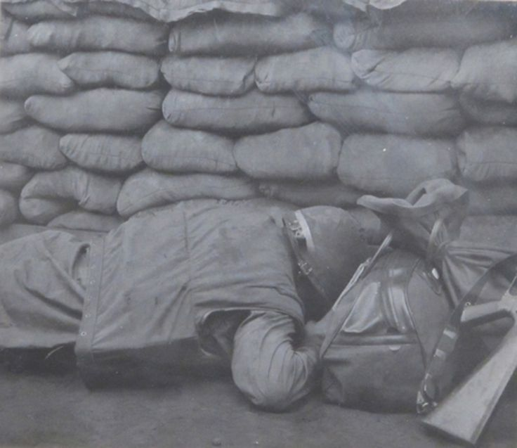A Marine tries to stay alive during an avalanche of NVA incoming. Khe Sanh Combat Base. 1968. BRAVO! COMMON MEN, UNCOMMON VALOR @https://bravotheproject.com/. #BRAVO! #USMC #KheSanh #VietnamWar #redclay #incoming No automatic alt text available.
