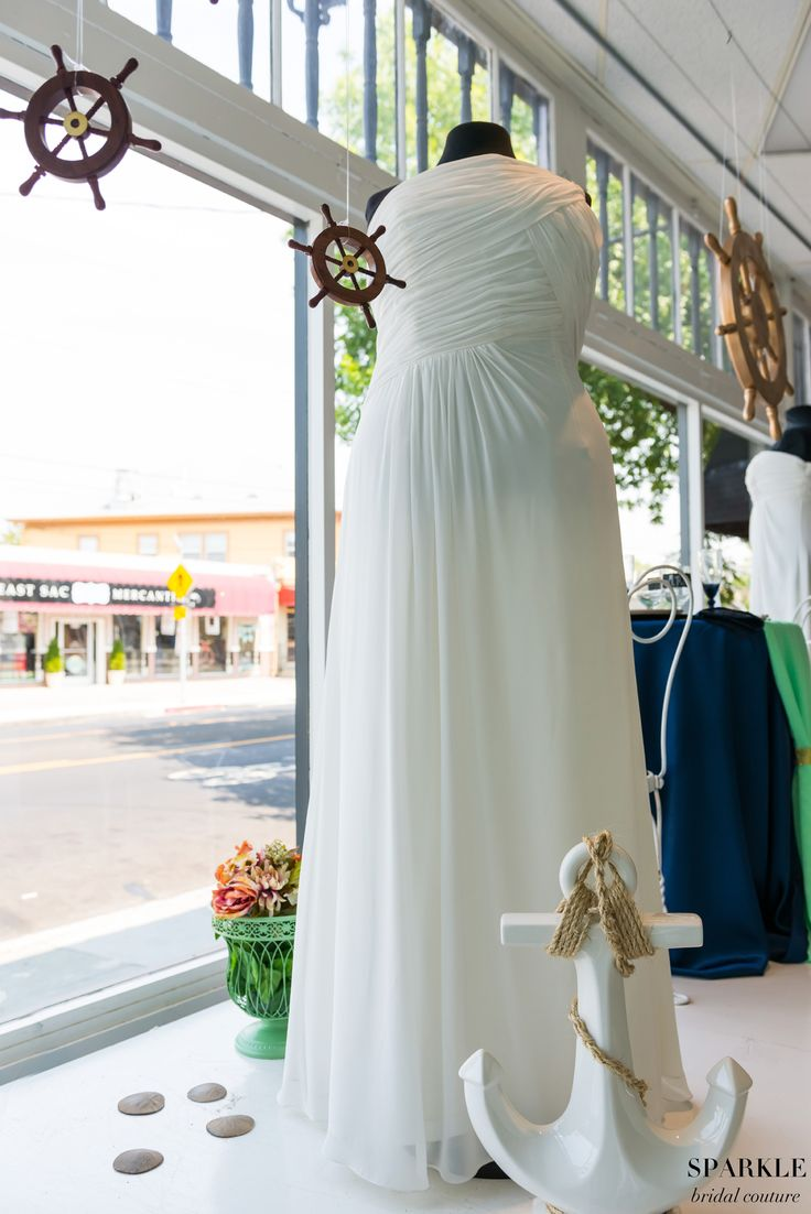 This one shoulder ruched chiffon gown would look charming among the sands of the beach.  #Nauticalwedding #Anchordecor #Weddingdecor #Sparklebridalcouture #Plussizebridal #Weddinggowns