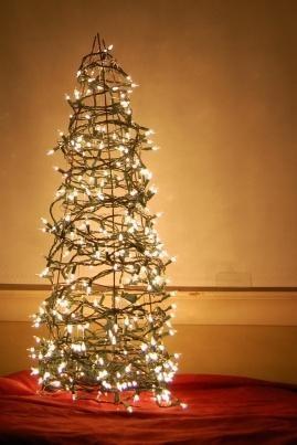 Tomato cage + lights = outdoor Christmas tree