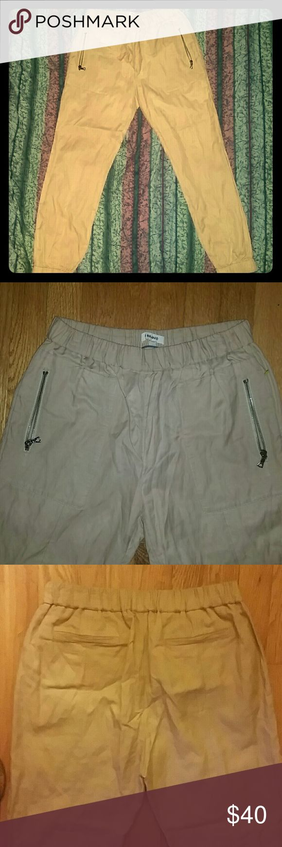 Flash Sale! NWOT J Brand Medium Khaki Jogger Pants NWOT J Brand Women's Khaki Jogger Pants in Medium. 50% cotton, 45% viscose, 5% metal. Thin material light khaki color with elastic banding at waist and ankles for comfortable, casual fit that can still pass in the office. J Brand Pants