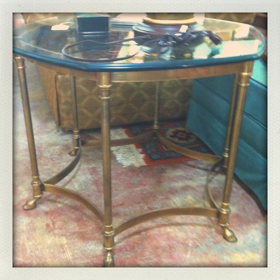 Brass glass-top side table with hoof feet detail!