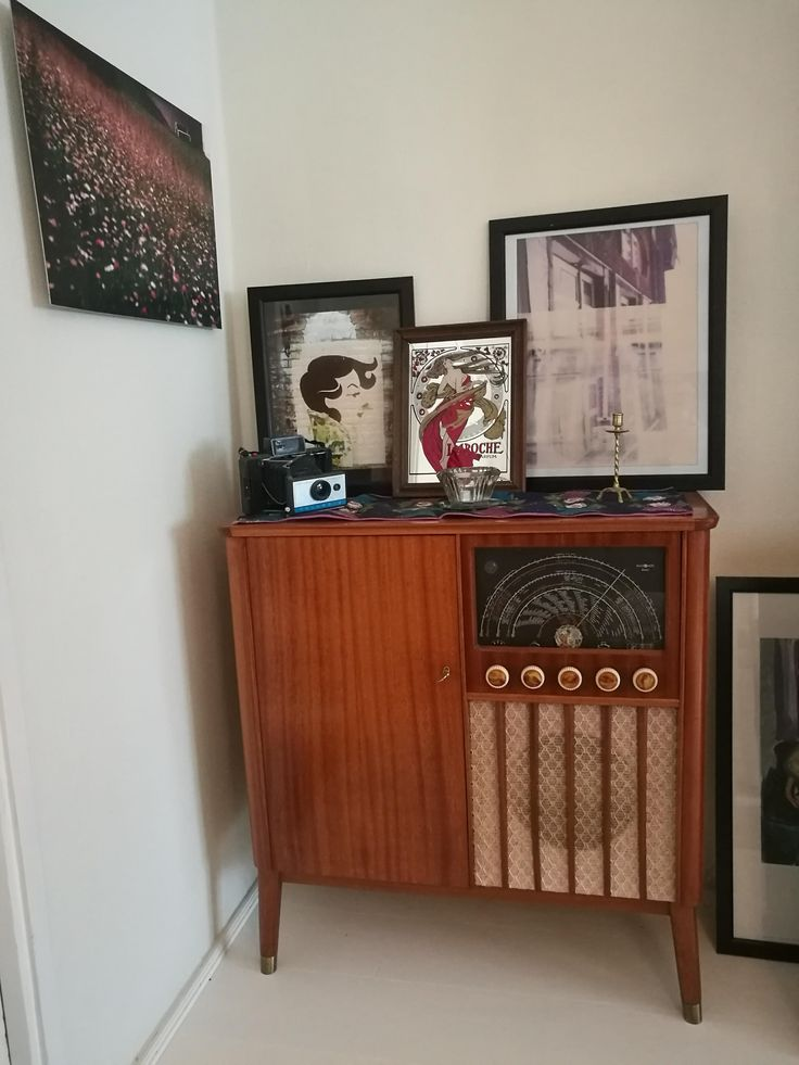 photos printed on aluminum (left), on photopaper (2nd left)) and enlarged polariod framed (right). Glass print in center is a mid century french art piece.
