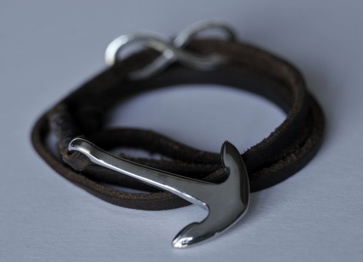 The Standhaft: A silver stainless steel anchor with a matching infinity charm, bound with 4mm brown genuine leather lace that adjusts to any wrist