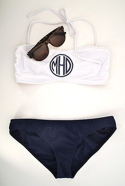 I want a monogramed bathing suit. maybe if i get in shape, this can be my reward? hahaha, who am i kidding.