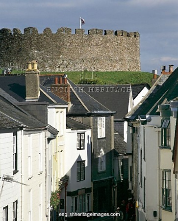 Totnes Castle, Totnes, Devon, is one of the best preserved examples of a Norman motte and bailey castle in England. The surviving stone keep and curtain wall date from around the 14th century.
