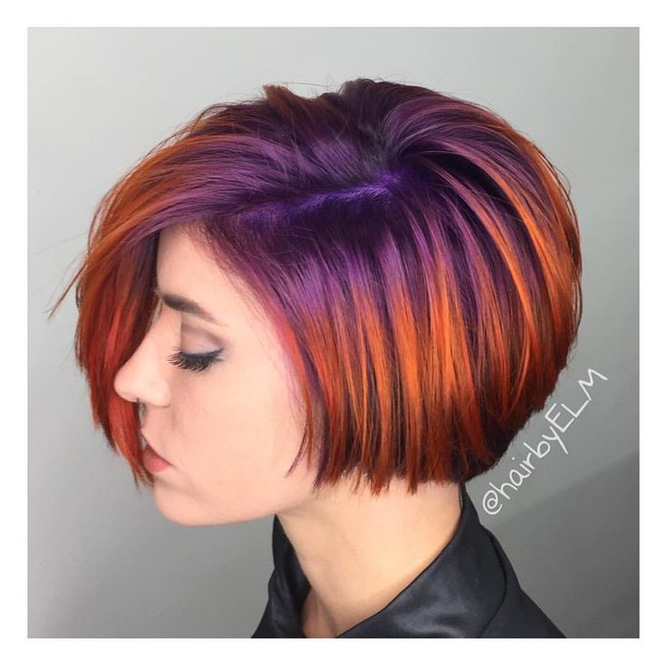 """""""✨ We are loving this short haircut with bright purple to violet base melted into a fiery copper red color design by @hairbyelm! #hotonbeauty #hothairvids"""""""
