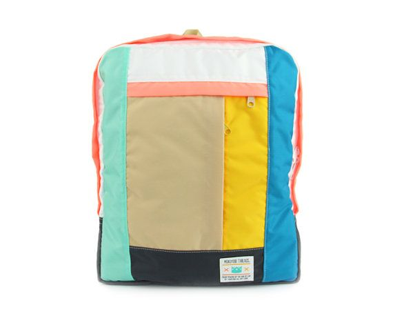 Multi Pocket Backpack color blocked like a dream! Simple backpack style with one horizontal and one vertical front zippered outside pocket.
