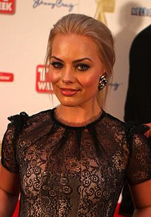 Margot Robbie - Australian actress. She first came to prominence for her role as Donna Freedman on the soap opera Neighbours (2008–2011). After moving to the US, Robbie starred as Laura Cameron in the ABC drama Pan Am & has appeared in films such as About Time & The Wolf of Wall Street (2013), which earned her multiple award nominations. Margot is due to star in the 2016 DC Comics film, Suicide Squad as Harley Quinn.