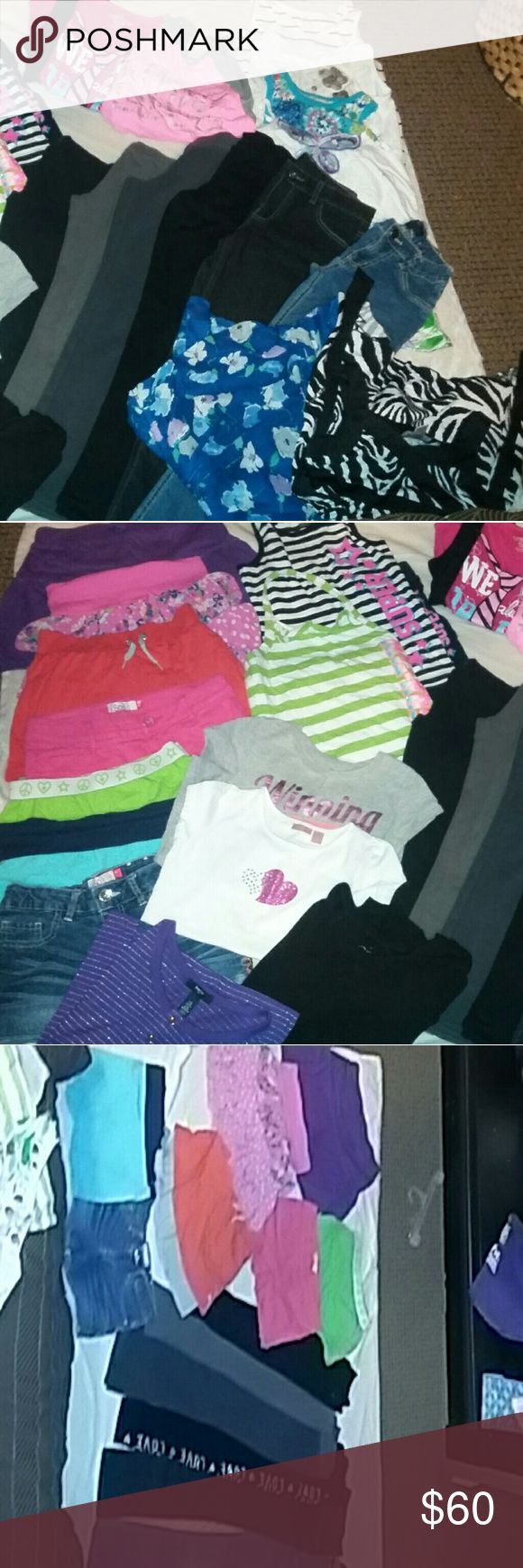 huge girl 10/12 lot lot includes... 2 pairs of jeans  2 skirts  3 pair of leggings  1 pair of fleece pants  1 scort  5 pairs of shorts  3 short sleeve shirts  3 long sleeve shirts  6 tang tops   includes Justice, Children's Place, SO, Gab Kids, and others Other