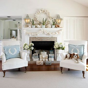 Christmas at the Shore - Long walks on the beach can result in some uncommon but exceptional Christmas decor. In this living room, handmade shell boxes fill the fireplace while a wreath made of seashells, starfish, and sea urchins occupies the space between two carriage-style sconces. Blue ultrasuede pillows featuring silhouettes of coral add comfort to a pair of chairs.