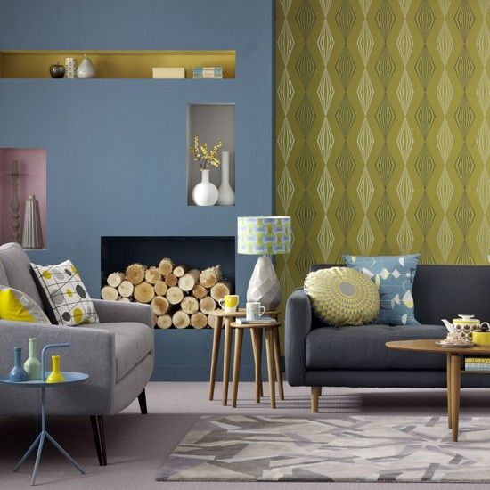 Blue and yellow living room graphic wallpaper teamed with soft blue paint and geometric prints Gray blue yellow living room