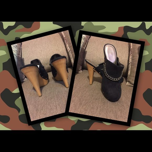 Faux Suede High Heel Clogs 4 inch heel Black faux dude heeled clog. Brand new. Love these with jeans or dress. Just never got to wear them. Black chain across front with studs. Super hot! Elle Shoes Heels