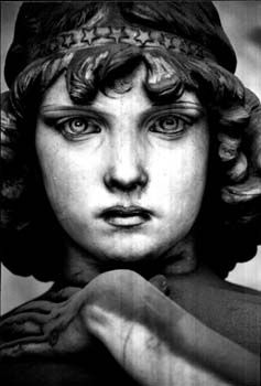Angel of the Resurrection ~ marble statue before the tomb of the Oneto family, sculpted by Giulio Monteverde, c.1882.