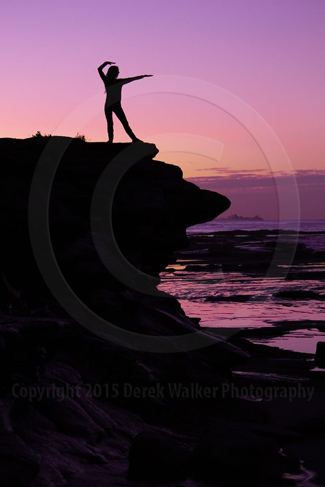 A woman practicing Tai Chi on the rocks by the sea at sunset. For image licensing enquiries, please feel welcome to contact me at derekwalker73@bigpond.com  Cheers :)