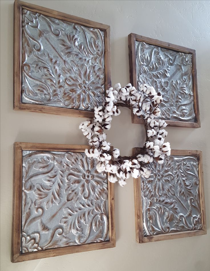 Metal and wood tin squares are the perfect answer to that huge wall with nothing on it...right?!?! That cotton wreath is just the icing on top! Rod Works has the best Wall Art selection, and the best help around!