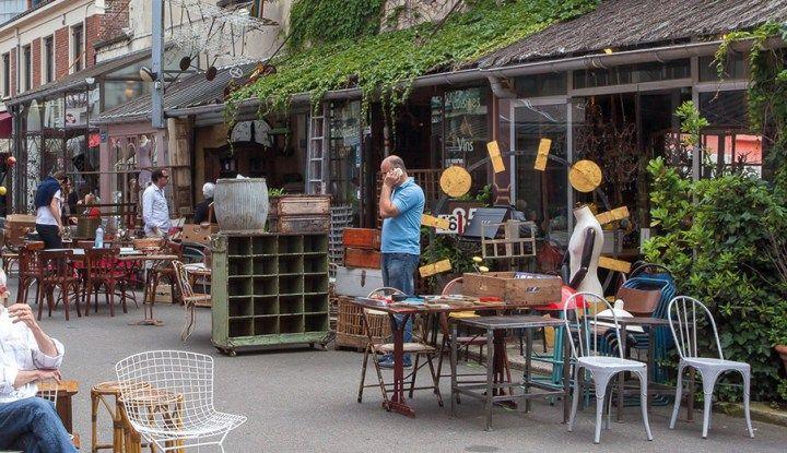 flea market merchants sitting outside their shop in st ouen flea market