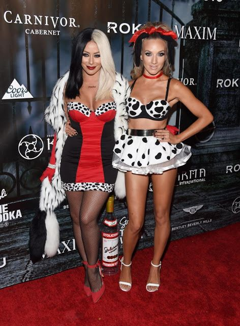 Stars on Halloween 2015  Danity Kane members Aubrey O'Day (l.) and Shannon Bex pulled off a perfect couple costume of Cruella de Vil and a Dalmatian for the Maxim Magazine Halloween Party on Oct. 24, 2015. Photo: Amanda Edwards/WireImage