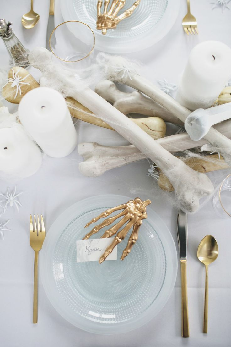 an all white ghostly halloween tabletop with bone and candle centerpiece runner   coco kelley