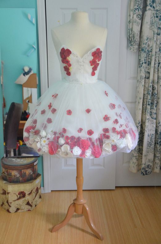 gogeous bubble skirt with fake flowers glued to the underskirt. this girl made a full tutorial for this dress.