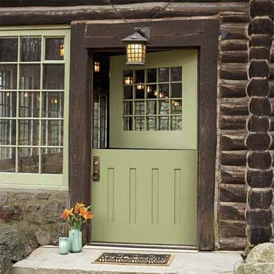 Log cabin with a distinctive Dutch door! | Photo: Laura Moss | thisoldhouse.com