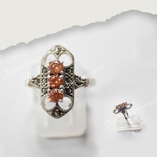 This sterling silver ring combines the delicate classic marcasite style and the beautiful natural citrine and is sure to make a standout addition to your collection.