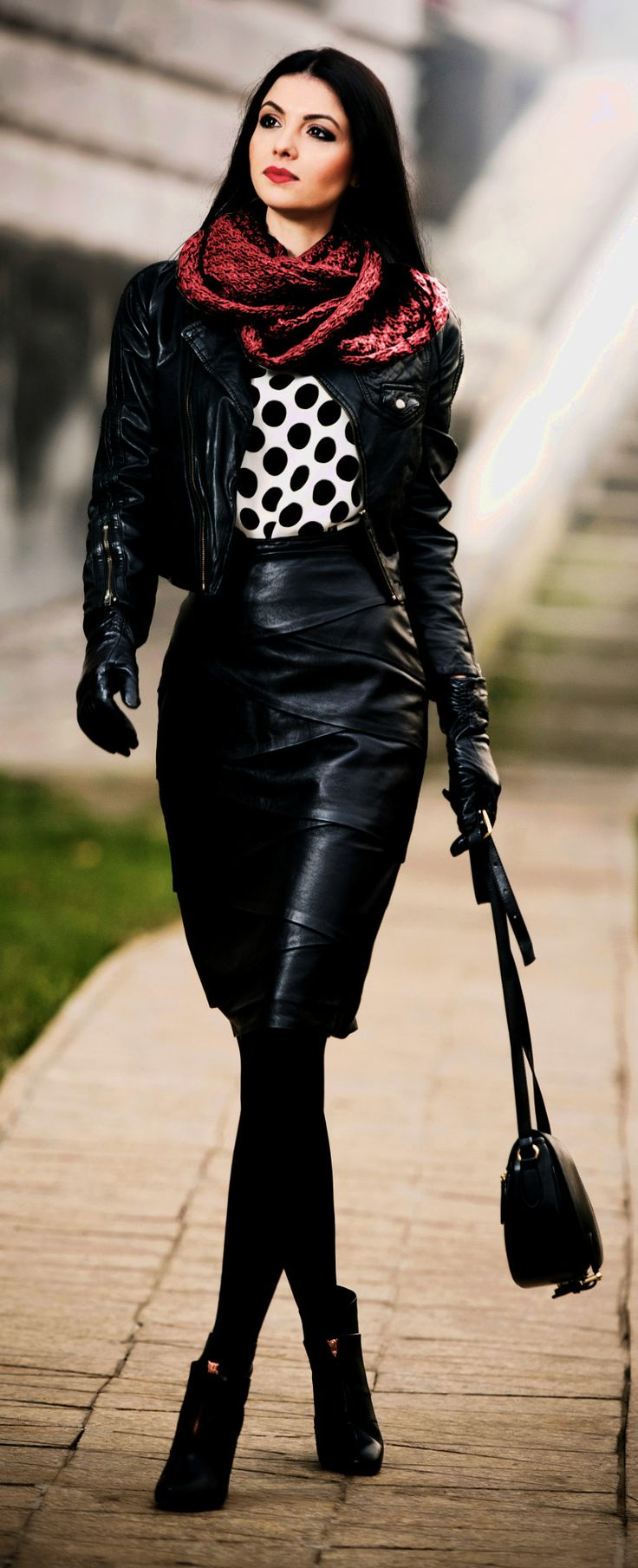 Supple black leather outfit: jacket, gloves, pencil skirt, opaque leggings and ankle boots.