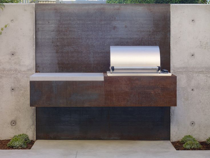 industrial patio by toposes - rusting steel plates that contrast a simple steel grill