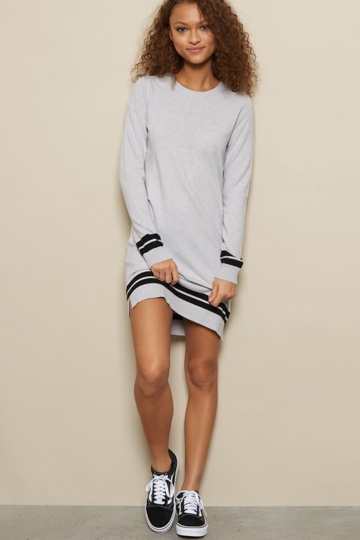 Super comfy, this sweater dress is soft to the touch and features sporty stripes to add that finishing touch.