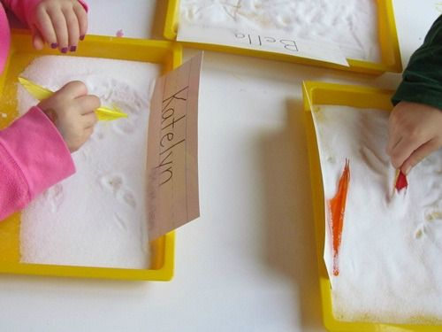 Feather Writing in Salt Trays. Repinned by playwithjoy.com. For more fine motor activity pins visit pinterest.com/playwithjoy