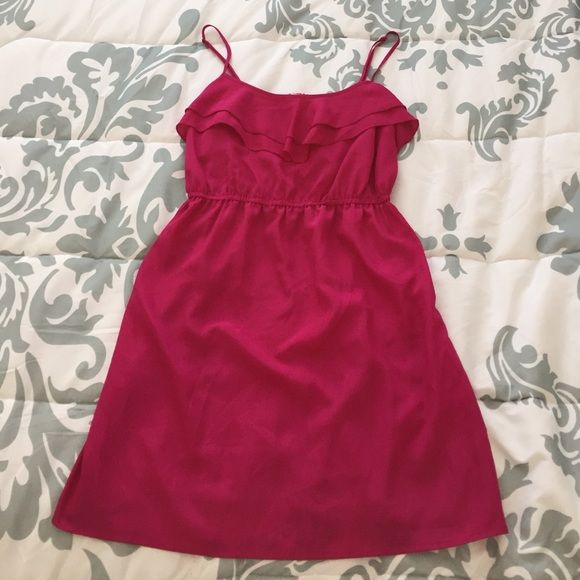 Forever 21 Fuschia Dress NWOT. Cute Fuschia dress with adjustable straps and ruffle detail at the neckline. Lightweight material - 100% polyester. SORRY, NO TRADES OR PAYPAL TRANSACTIONS. Forever 21 Dresses