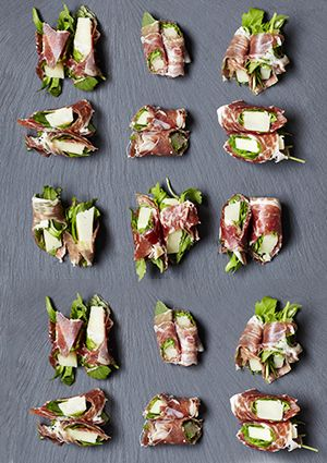 Ibérico, manchego and rocket bites - A super sophisticated party nibble, or canapé for a Christmas dinner party. We all know how well Ibérico ham and manchego ham go together - add rocket for extra punch, and serve alongside a glass (or two) of fizz.
